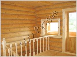 Фотография элементов отделки деревянного дома. Декоративная конопатка канатиком