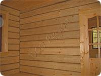 Стена деревянного дома рубленого в крюк